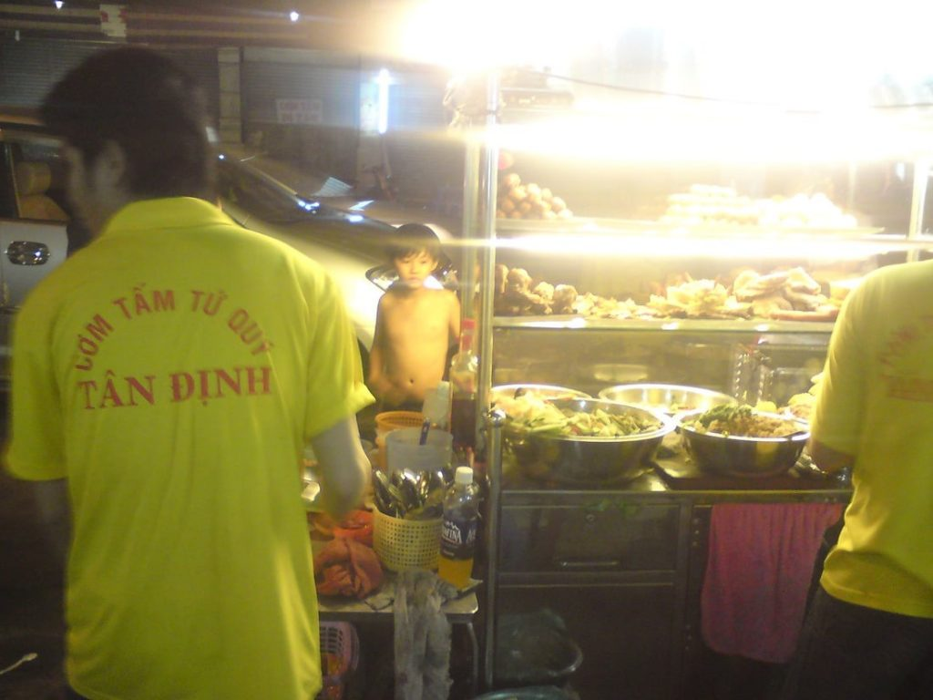 Local cơm tấm eatery at night - Tân Định Market, Saigon