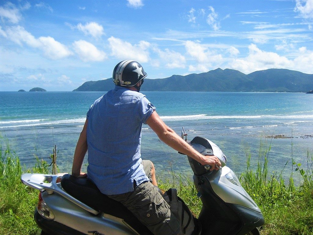 Riding a motorbike on Con Son Island, Con Dao, Vietnam