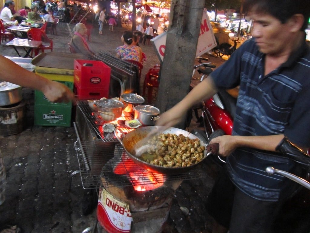 Cooking snails in Saigon, Vietnam