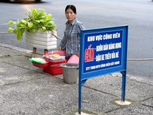 Street hawker: the sign says 'No selling on the street'