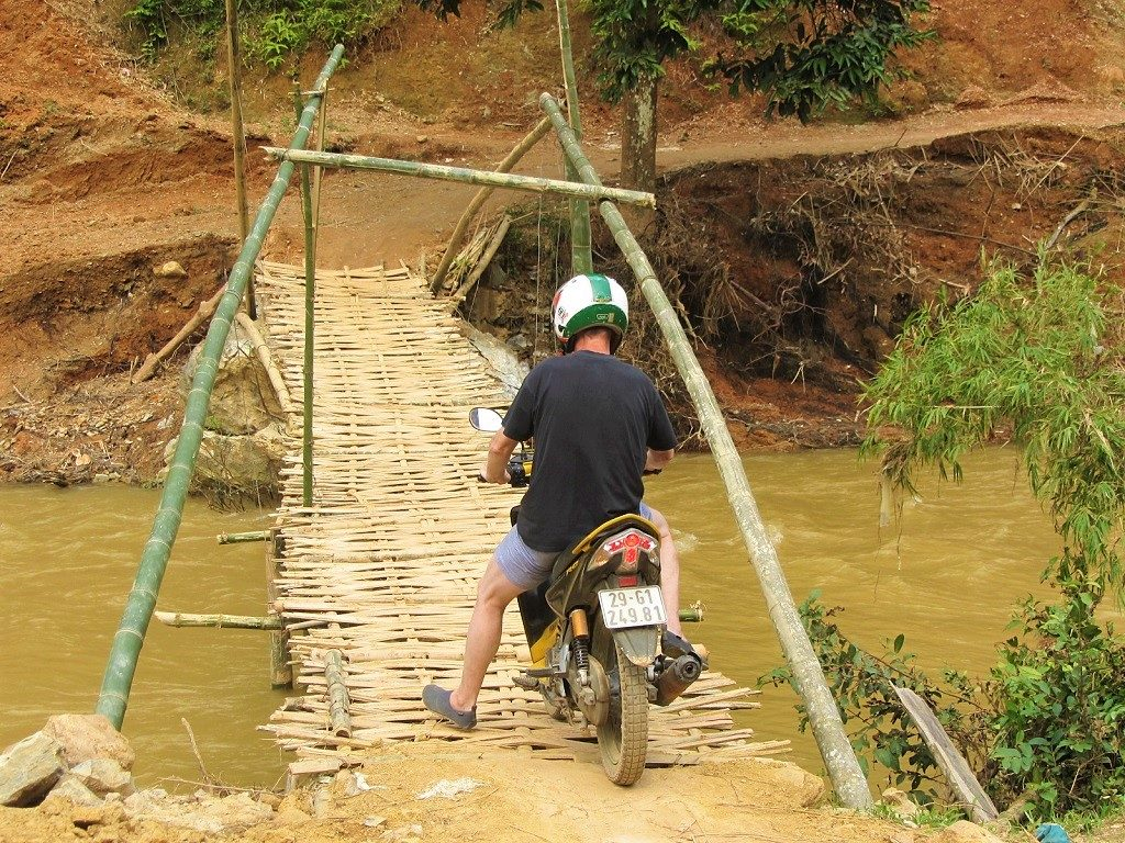 Riding over a bamboo bridge in Pu Luong Nature Reserve, Vietnam