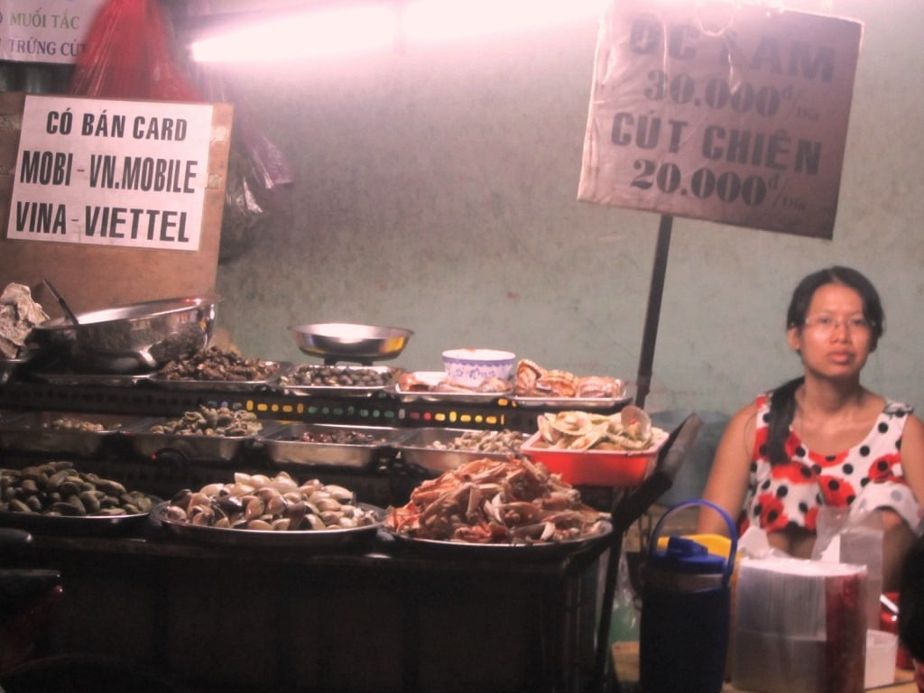 Shellfish vendor, District 4 alleys, Saigon, Vietnam