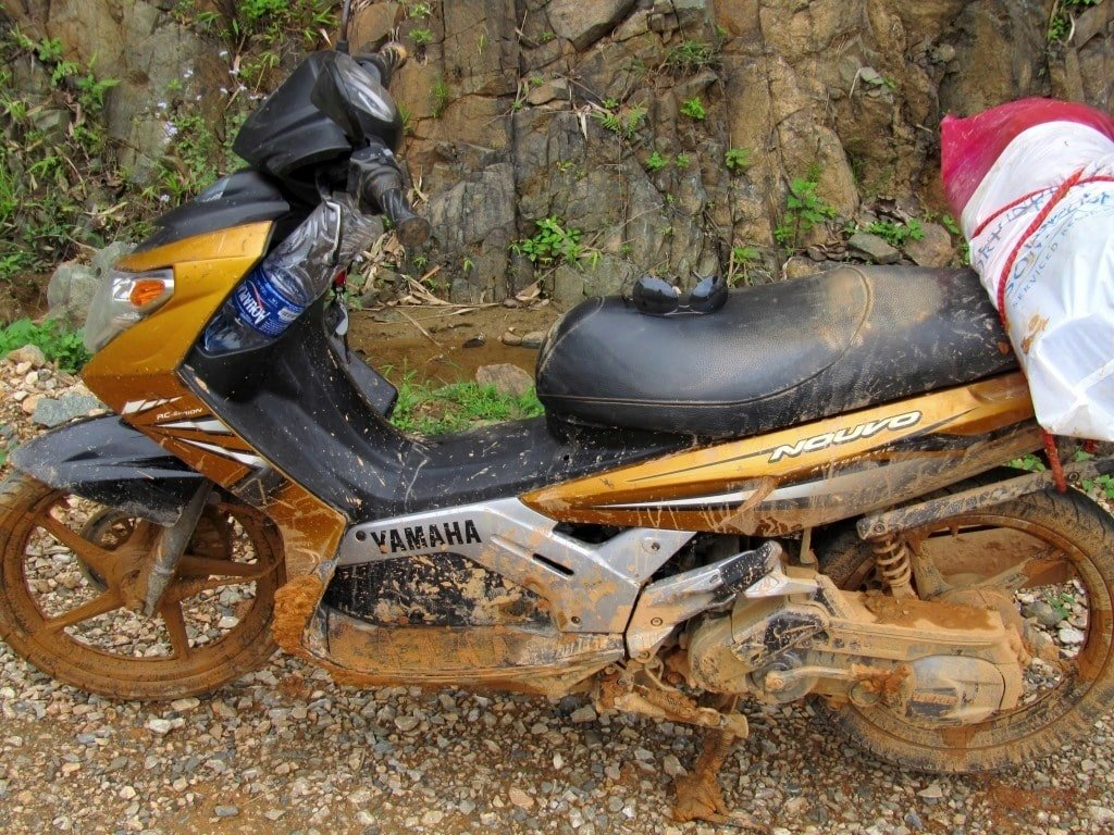 Stavros, my motorbike, covered in mud, northern Vietnam