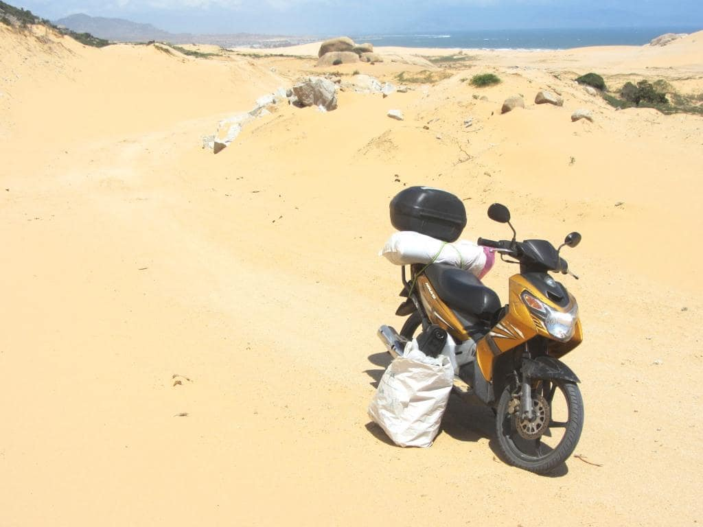 Stavros, my motorbike, in the sands of Vietnam's desert