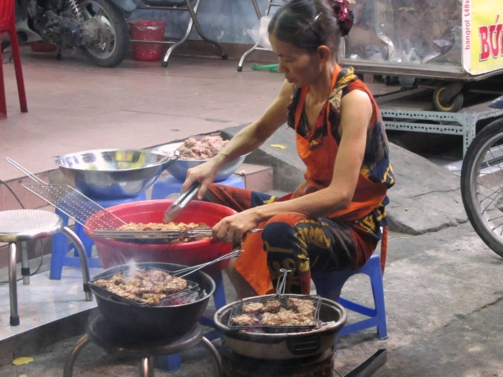 Grilling on the sidewalk for bún chả
