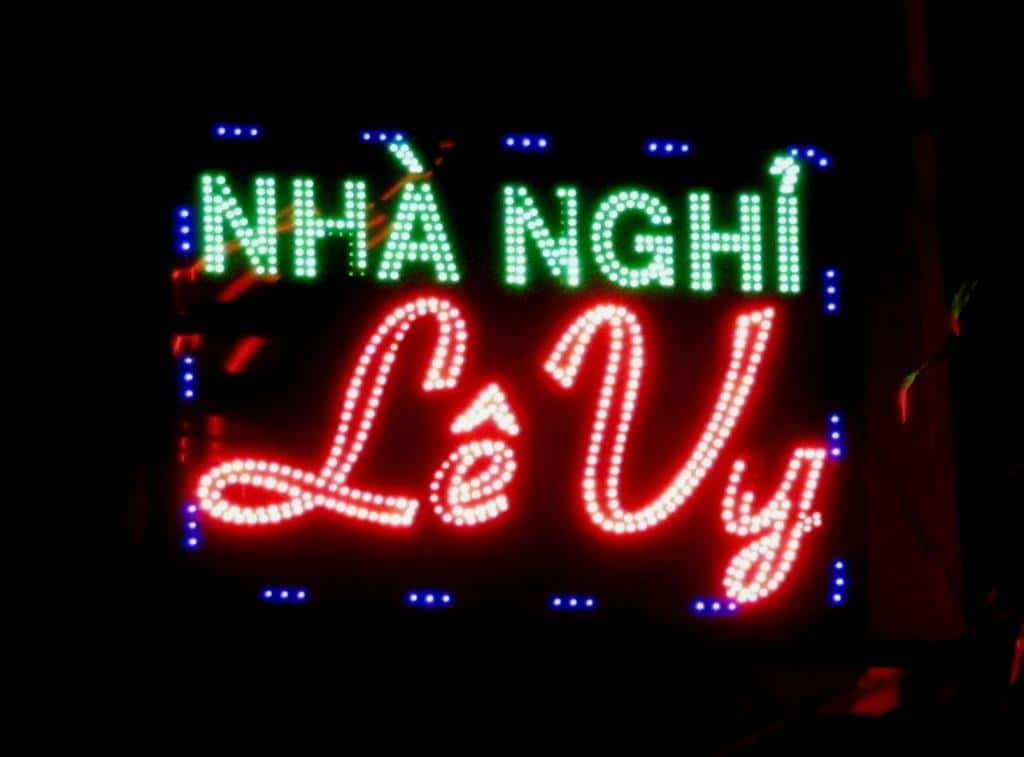 Sign for a nhà nghỉ (local guesthouse) in Vietnam