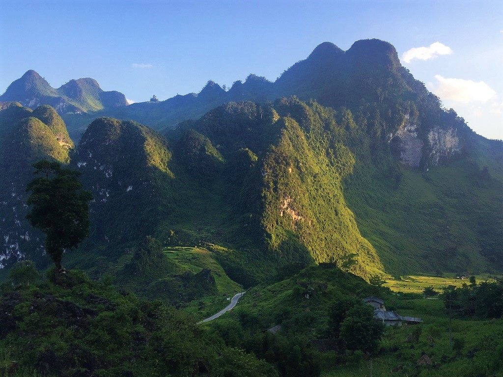 A road ploughs through limestone valleys, Meo Vac, Ha Giang