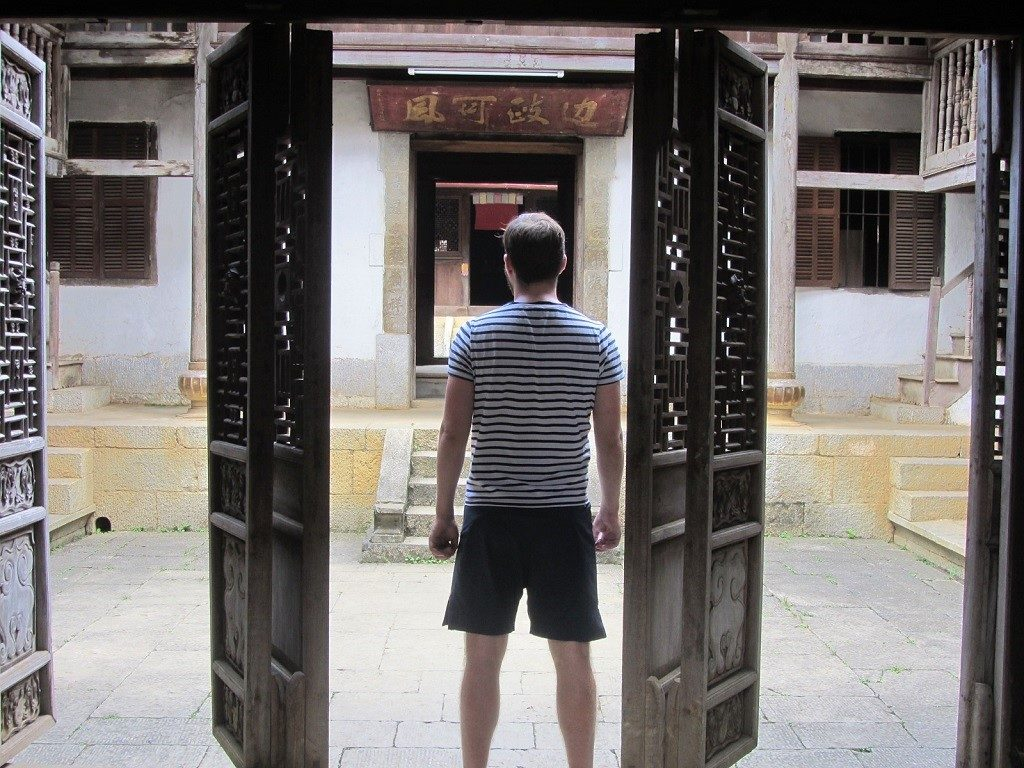 Entering the courtyard of the H'mong King's palace, Sa Phin, Ha Giang