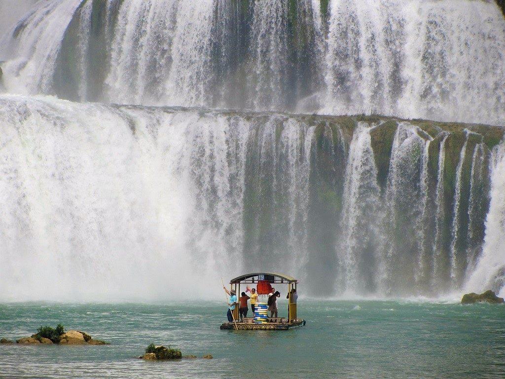 Punting on bamboo rafts, Ban Gioc Waterfall, Cao Bang Province
