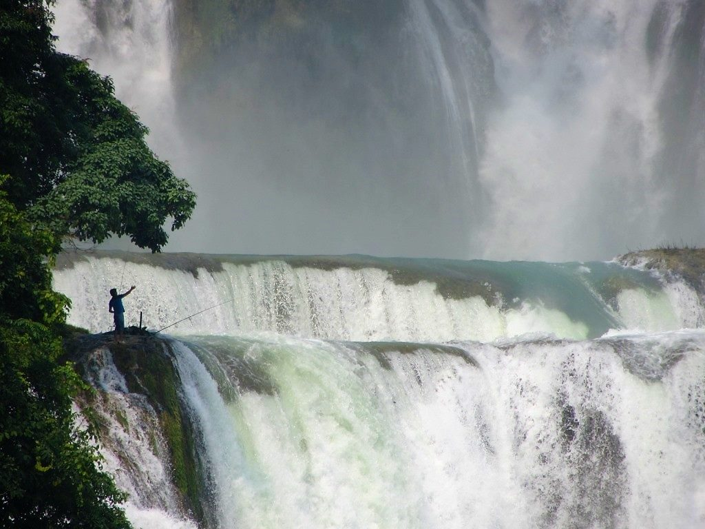 Fishing from the cascade, Ban Gioc Waterfall, Cao Bang Province