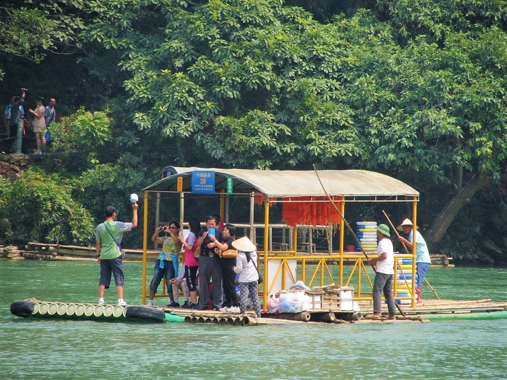 A Vietnamese floating vendor & a Chinese tourist raft, Ban Gioc Waterfall