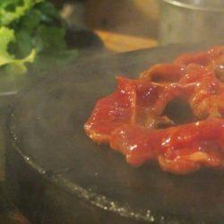 Grilling on hot rocks at Chu Quán