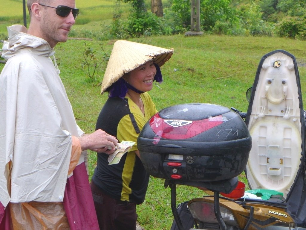 Buying gas on the road in Vietnam