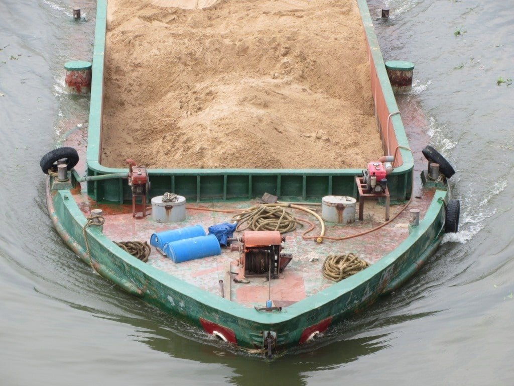 An industrial barge on the Saigon River, Vietnam
