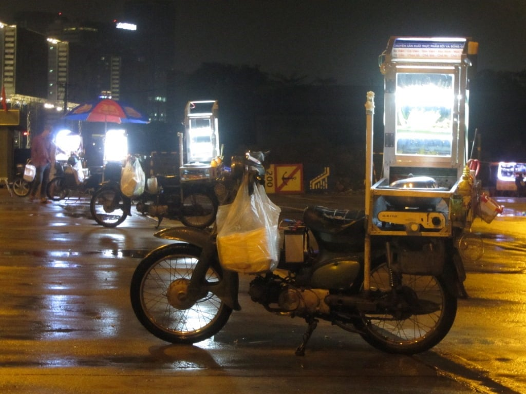 Motorbike street food vendor at night, District 2, Saigon