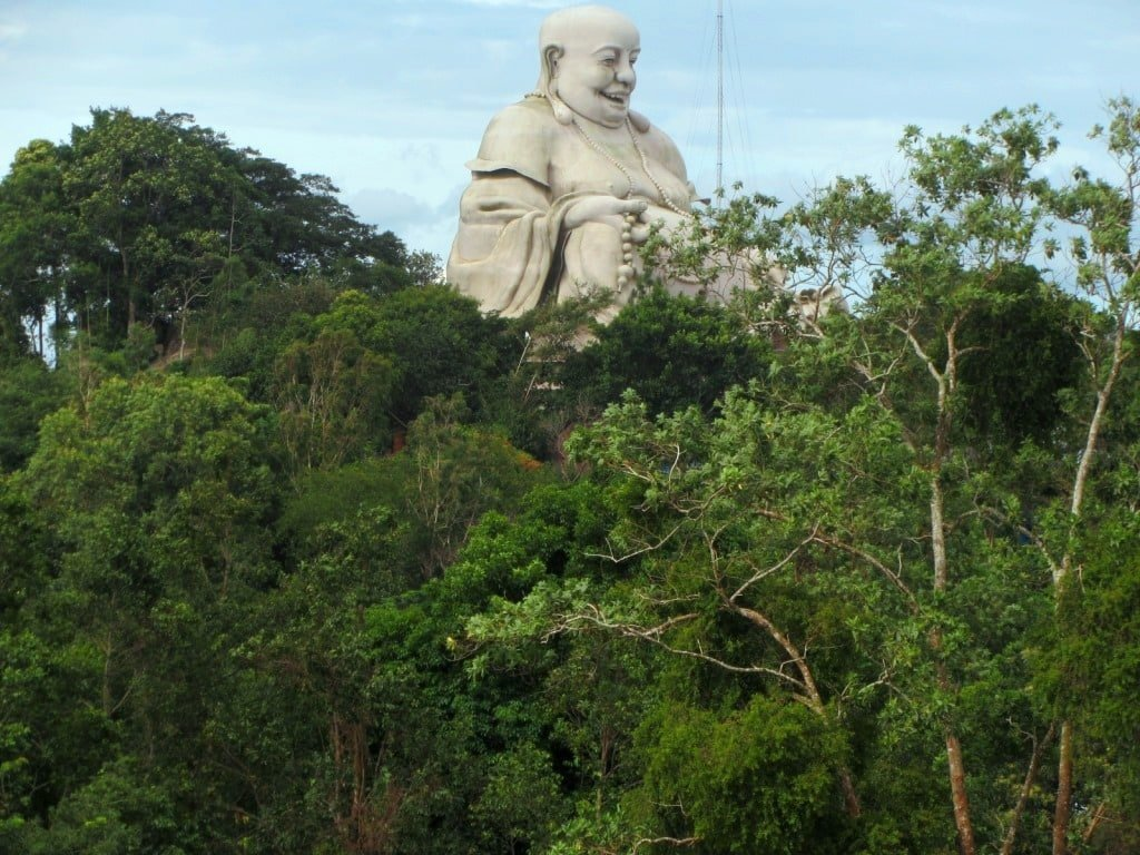 Giant statue of seated Buddha, Nui Cam Mountain, An Giang Province, Mekong Delta, Vietnam