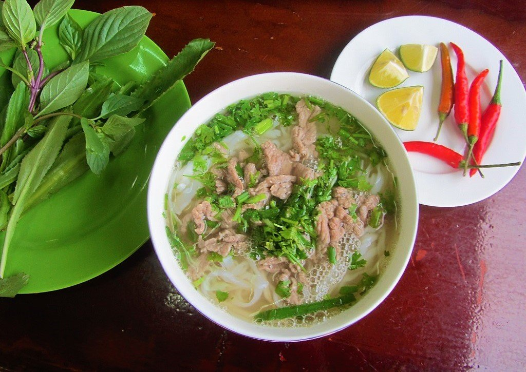 A bowl of phở beef noodles on the train