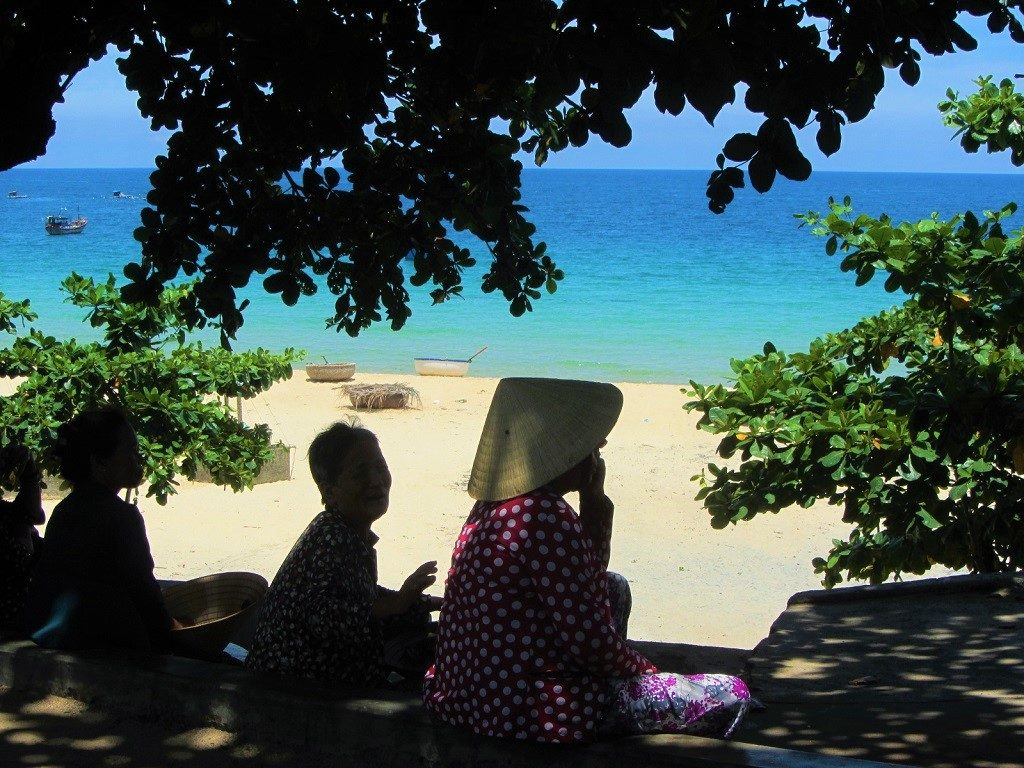 Women talking on Bãi Rạng Beach, Quy Nhon, Vietnam