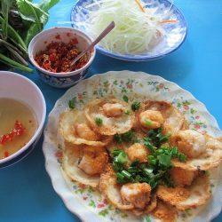 Eating bánh khọt in Vung Tau, Vietnam