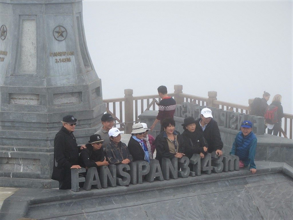 Tour groups at Fansipan mountain summit, Vietnam