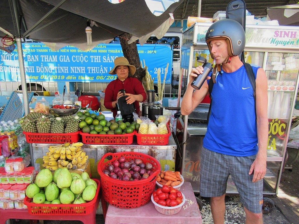 Drinking from my reusable thermos flask at a juice vendor, Vietnam