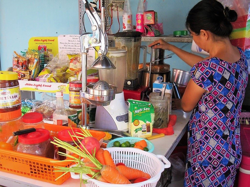 Filling my reusable thermos at a juice vendor in Saigon