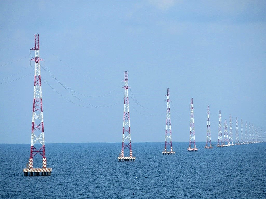 Electricity pylons in the sea, Hon Son Island, Vietnam