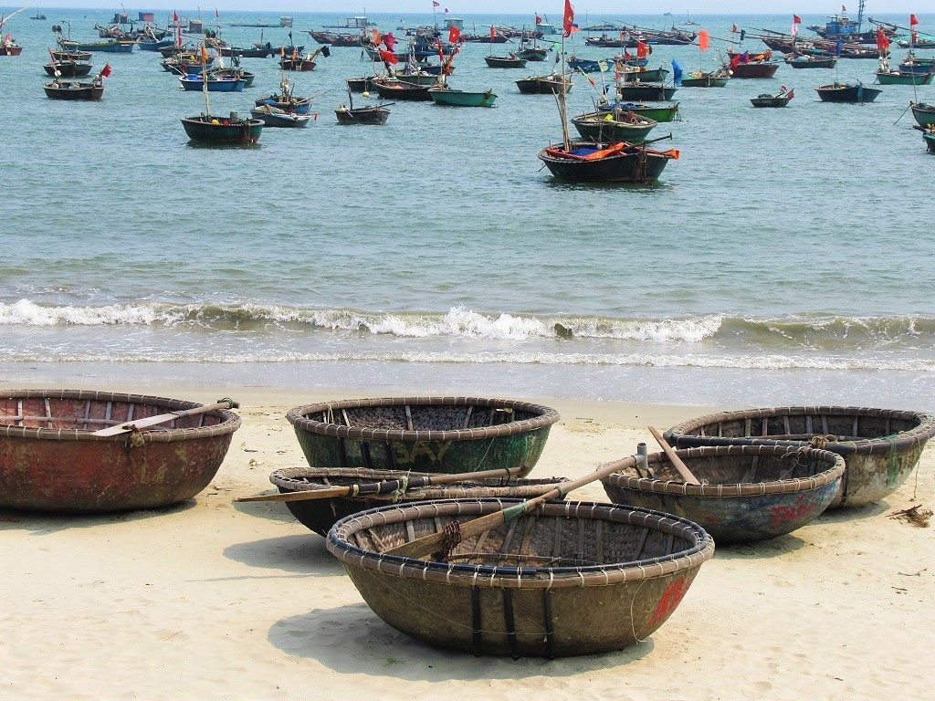 Fishing coracles in the sea, Danang, Vietnam