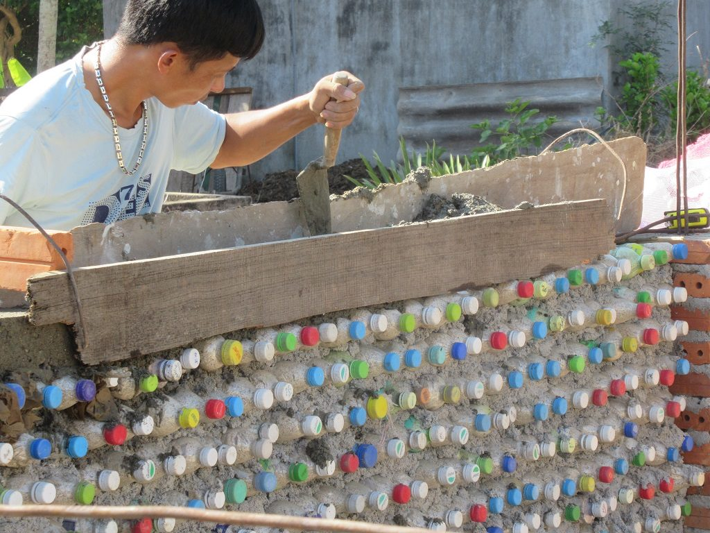 Recycled plastic bottle wall, Ly Son Island, Vietnam