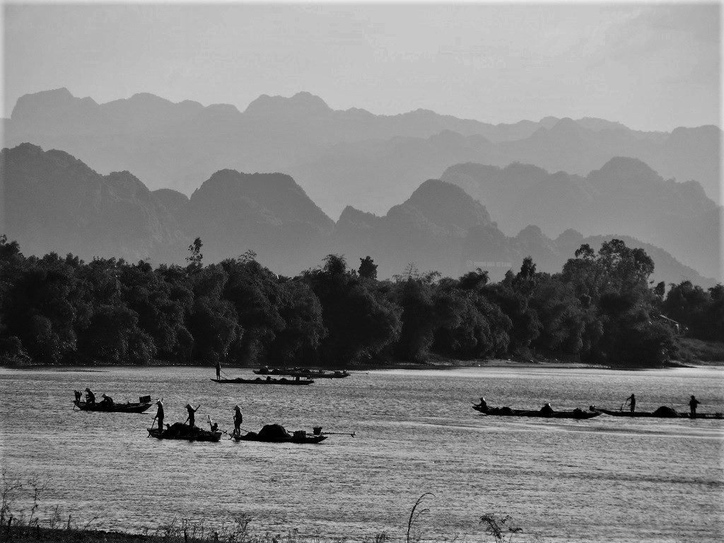 Fishing sampans on the river, Phong Nha, Vietnam