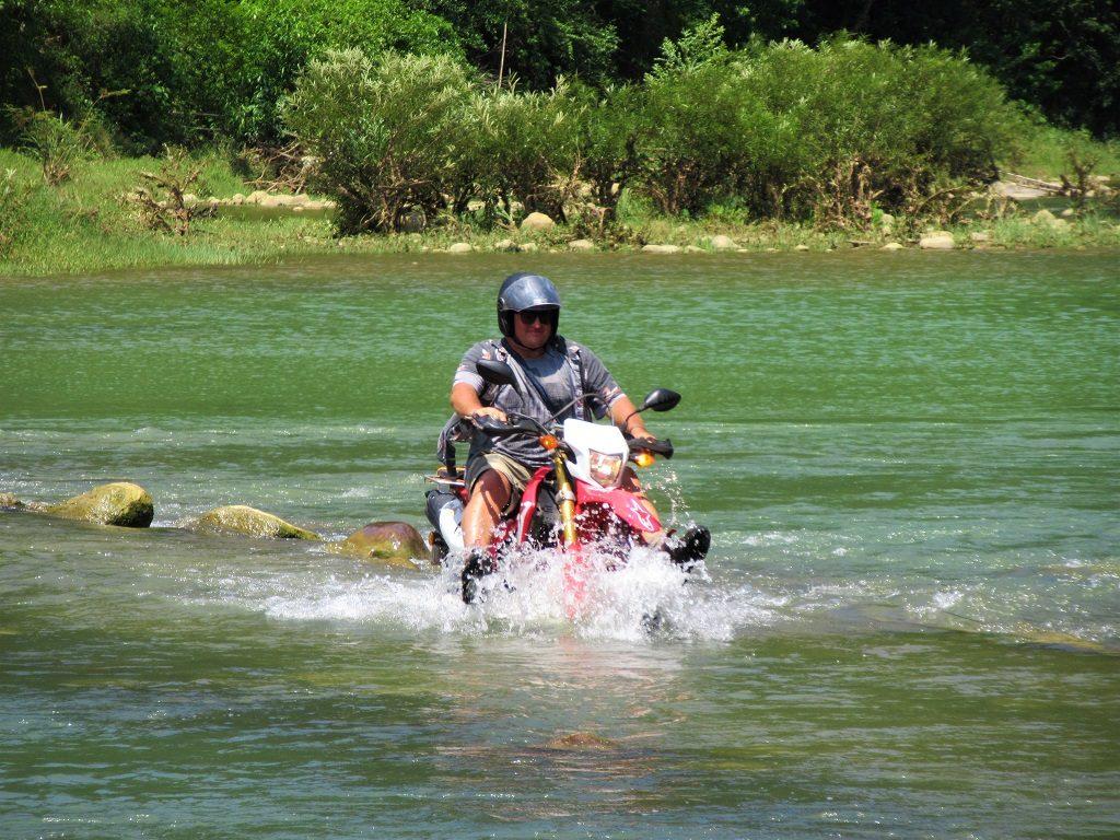 Riding through a river, Phong Nha, Vietnam