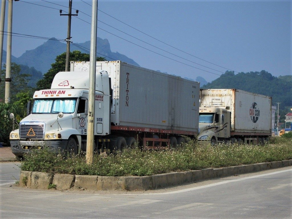 Truckers stopping by the roadside for lunch, Vietnam