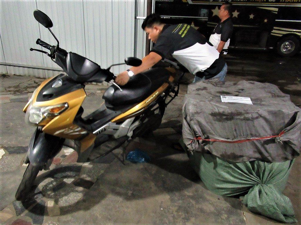Taking my motorbike on the Thien Thanh Limousine Bus, Saigon to Rach Gia, Vietnam
