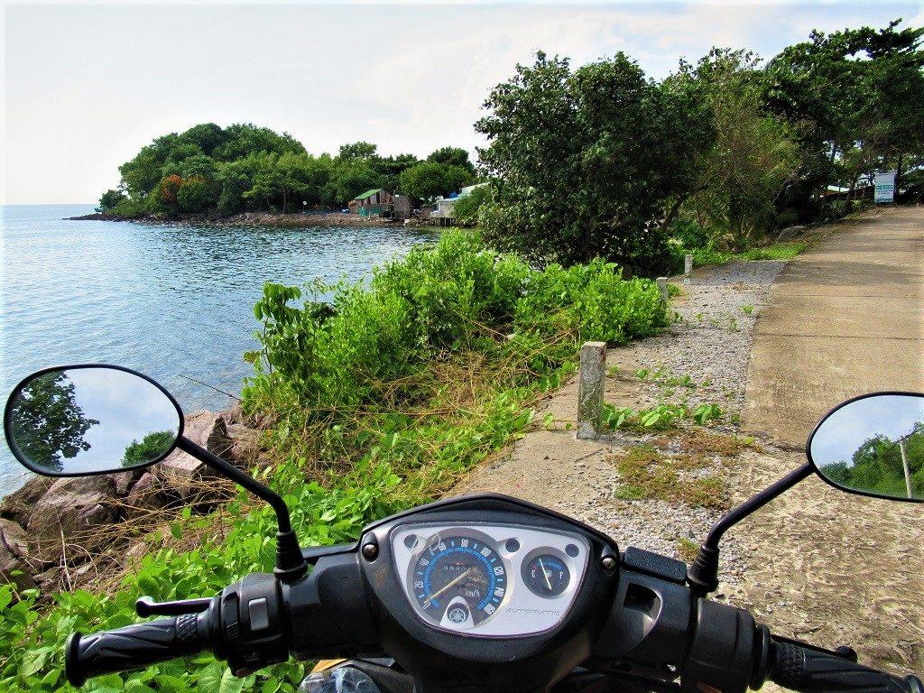 Getting around Pirate Island by motorbike, Hai Tac Archipelago, Vietnam