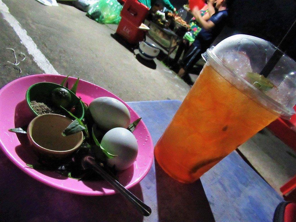 A glass of trà tắc (iced calamansi tea) on Pirate Island, Hai Tac Archipelago, Vietnam