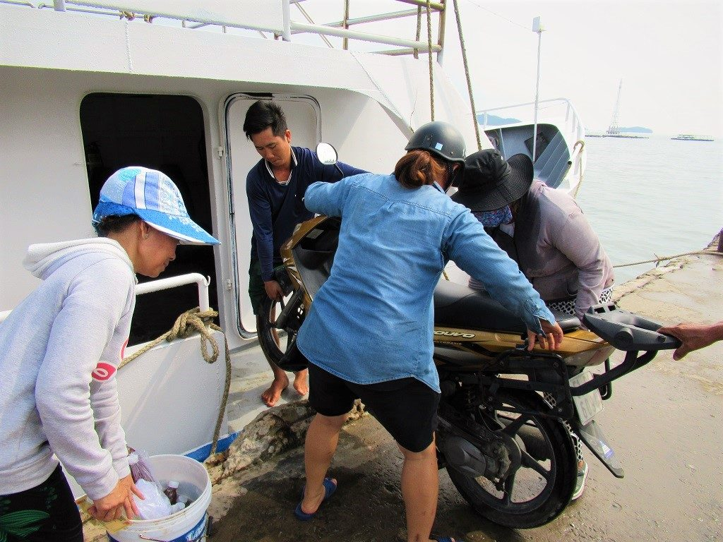 Loading a motorbike onto the Ha Tien-Pirate Island ferry, Vietnam