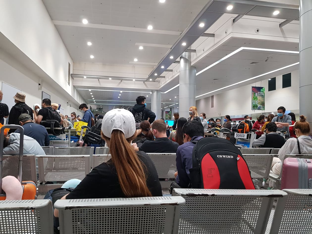 Waiting for instructions at the airport before transferring to COVID-19 quarantine facility, Vietnam