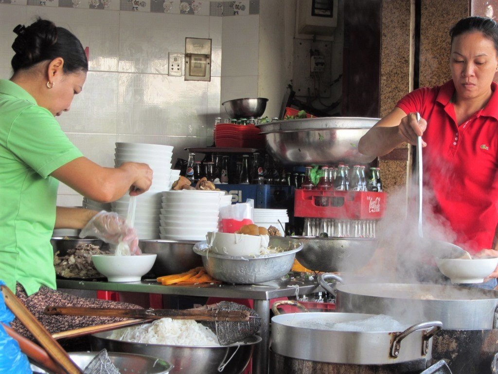 Preparing a bowl of phở noodles in Saigon, Ho Chi Minh City, Vietnam