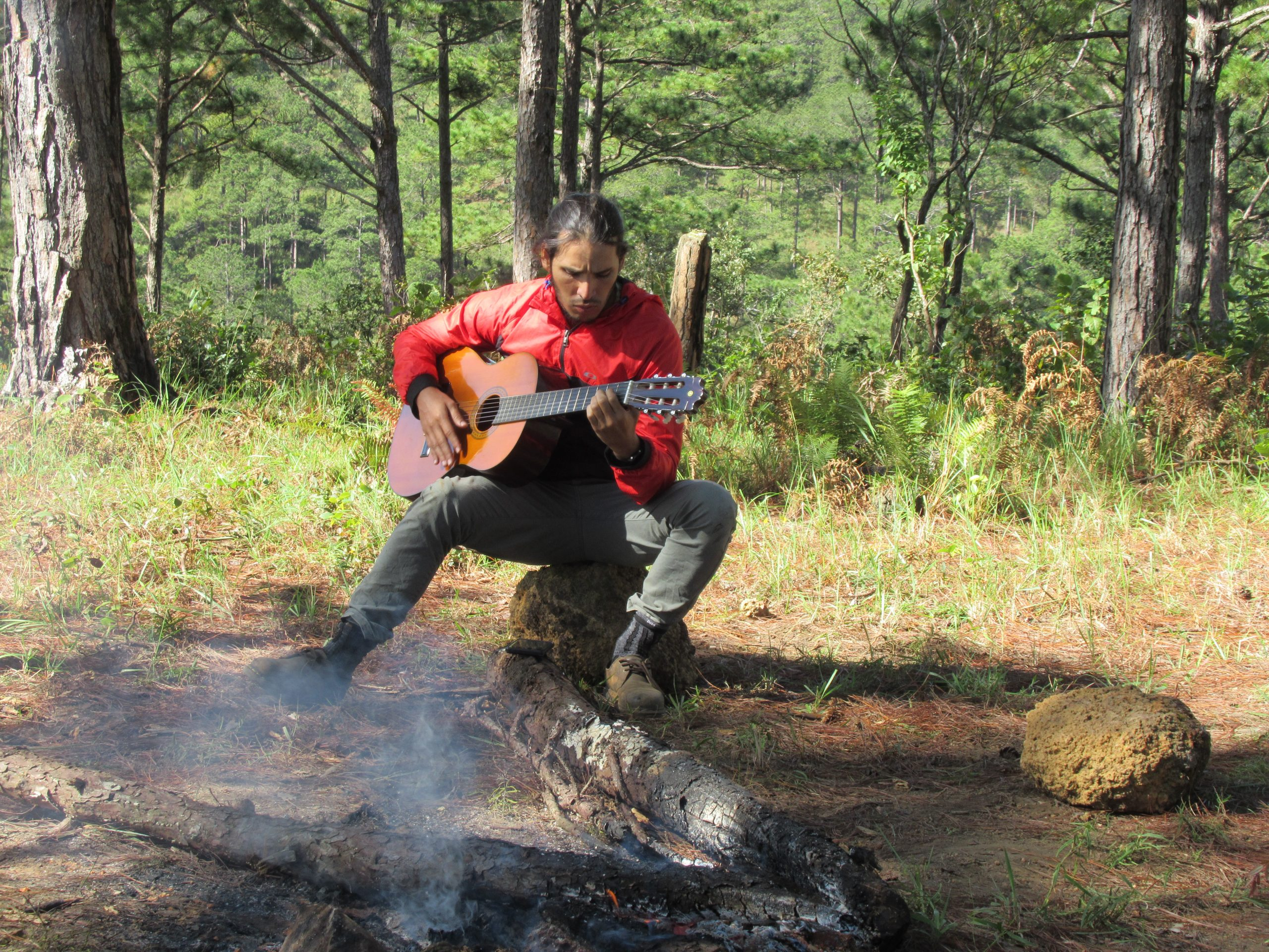 Playing guitar around the campfire