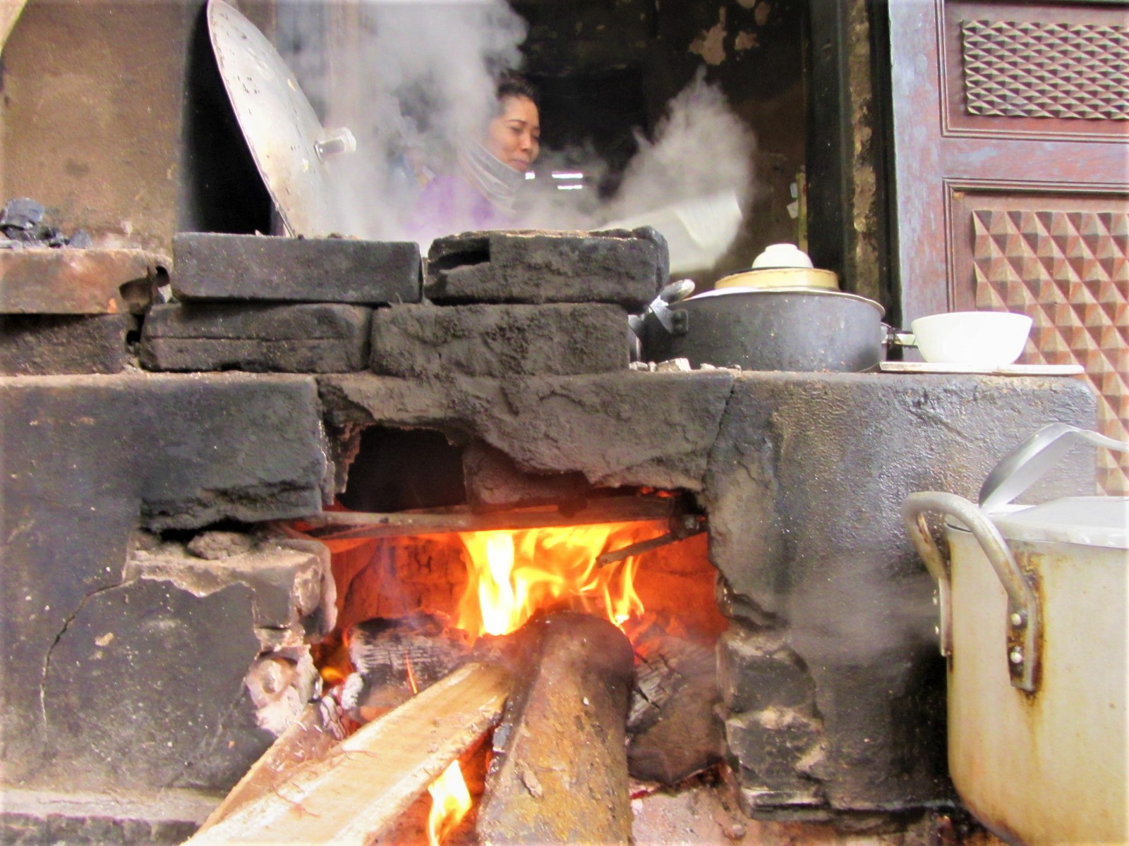 Cooking fire at breakfast in Ha Giang City