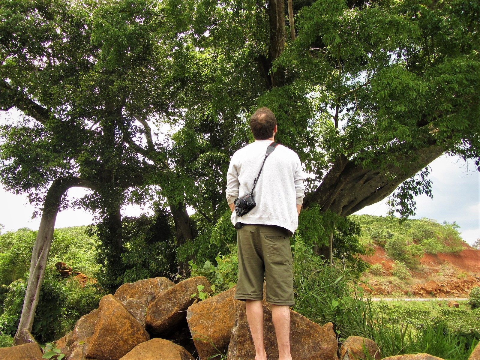 Thom standing under his first banyan tree, Central Highlands, Vietnam