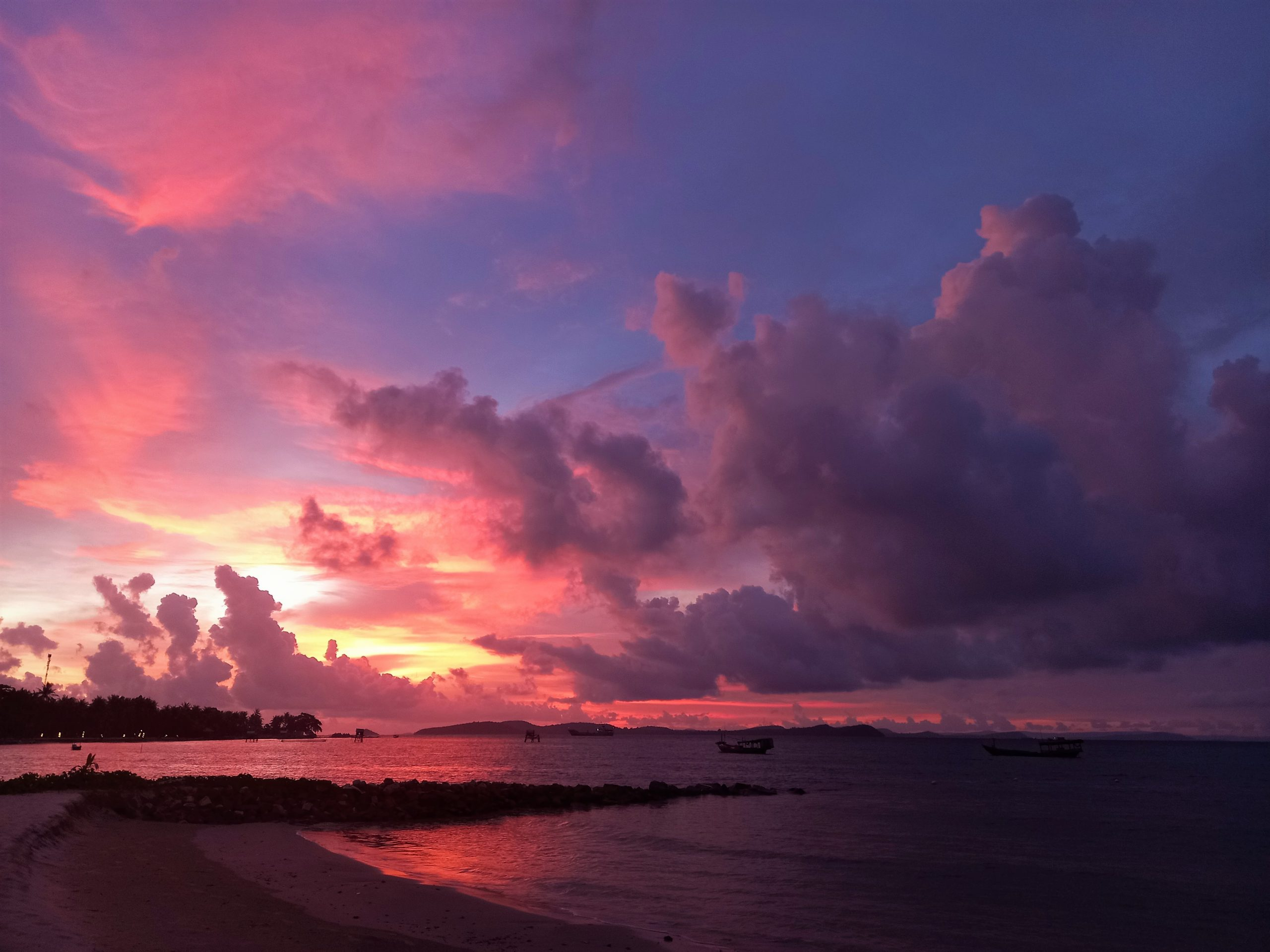 Sunset after a tropical downpour at the tail end of rainy season in southern Vietnam