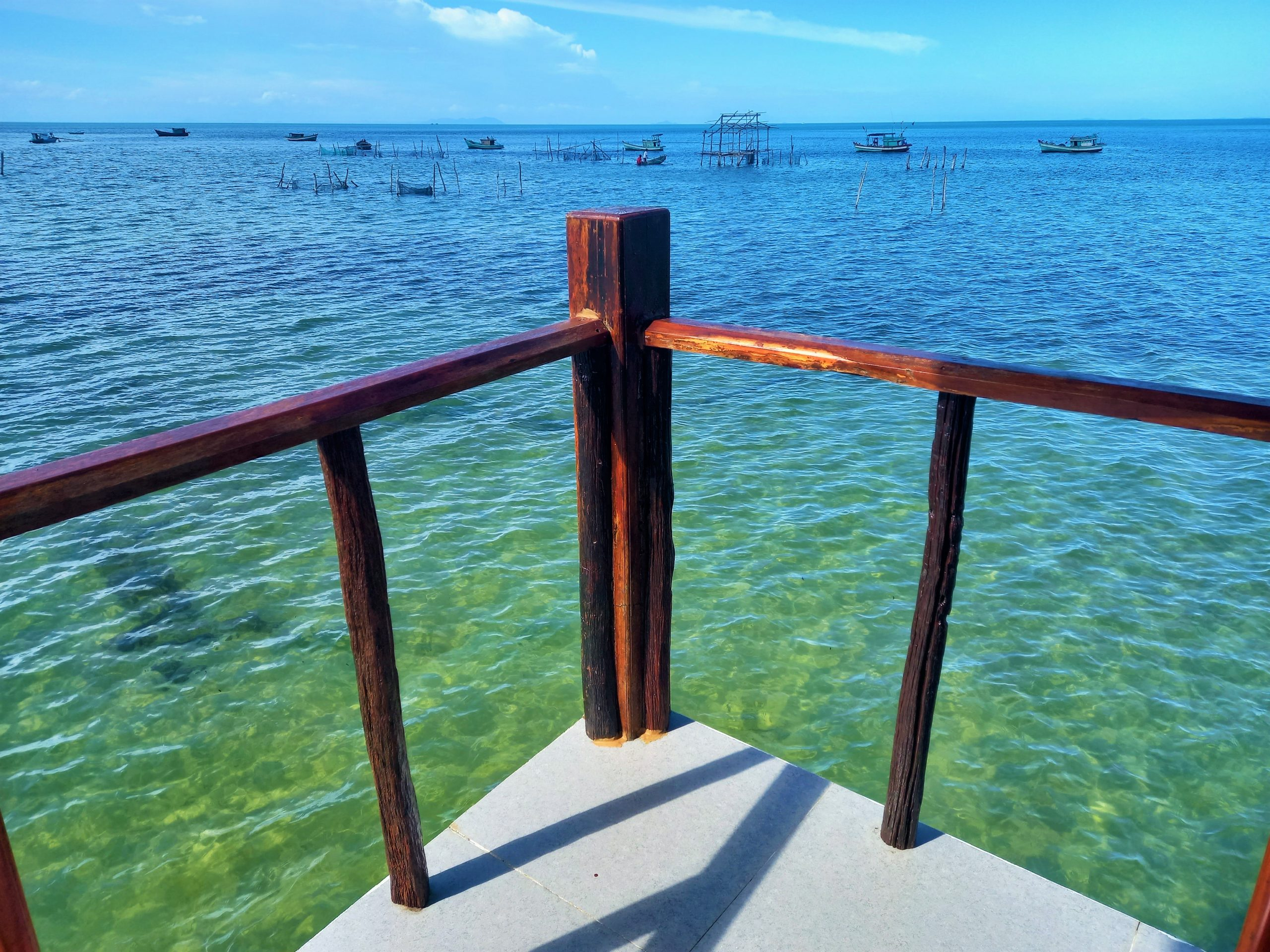 The shallow sea at high tide seen from a bungalow