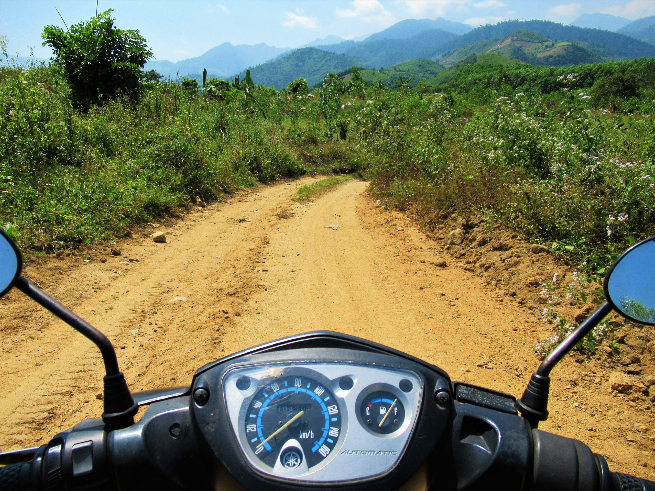 Dirt roads towards the Khanh Vinh Tributaries to find wild campsites, south-central Vietnam