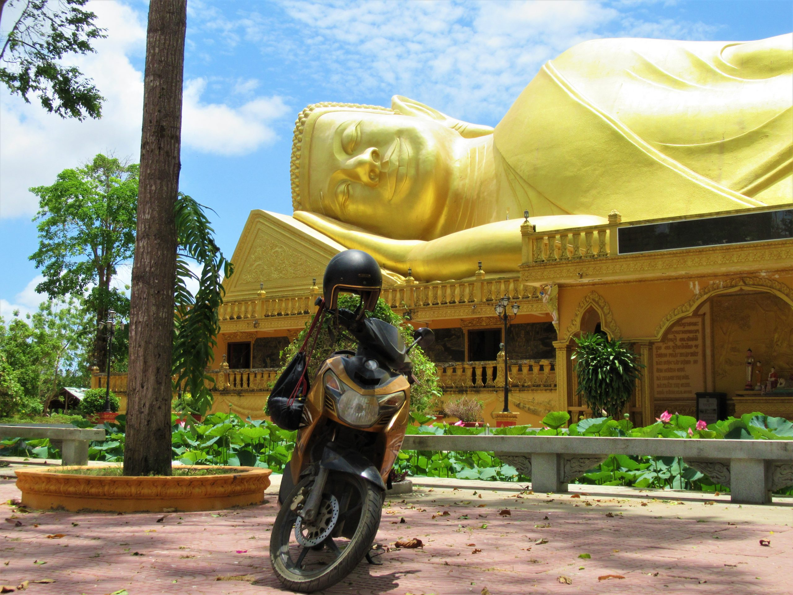 Next to a colossal reclining Buddha on the Temple-Hopping Loop, Tra Vinh, Mekong Delta