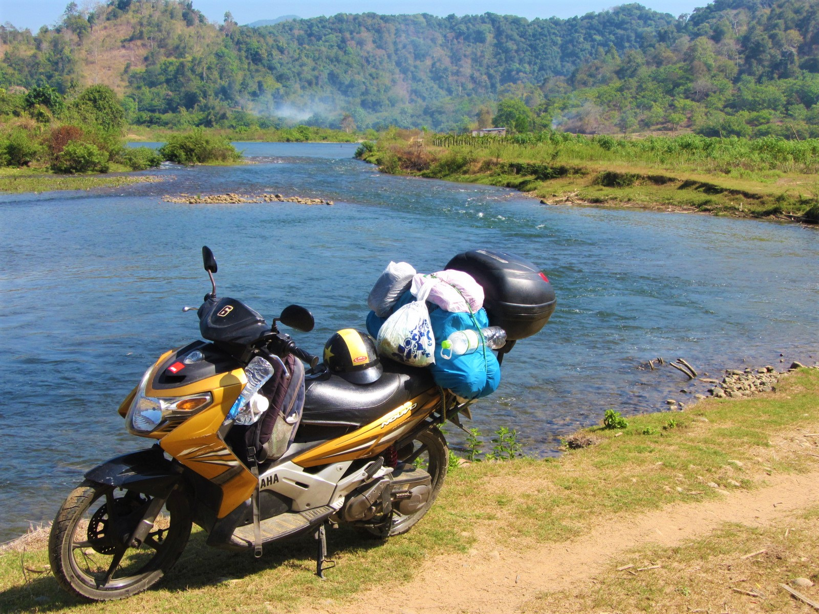Scouting for campsites on dirt paths along the banks of the La Nga River, Central Highlands