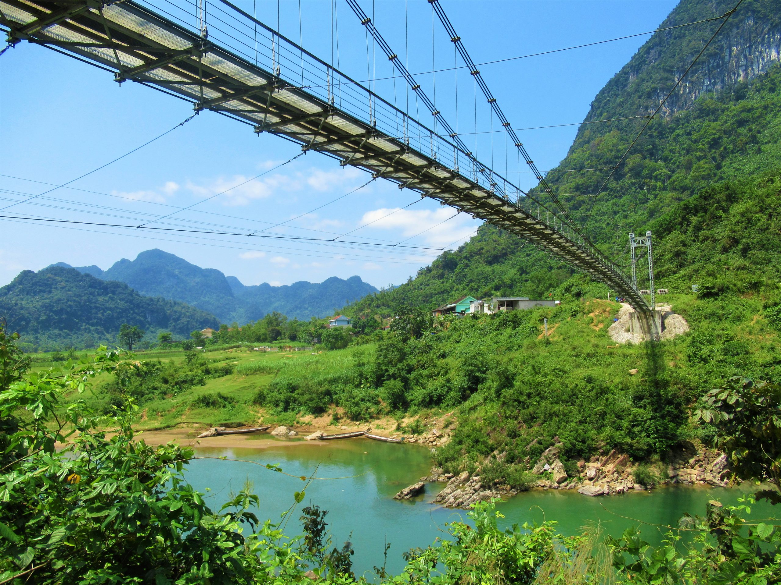 A suspension bridge on the Long Dai River, Ho Chi Minh West is Best Loop, Central Vietnam