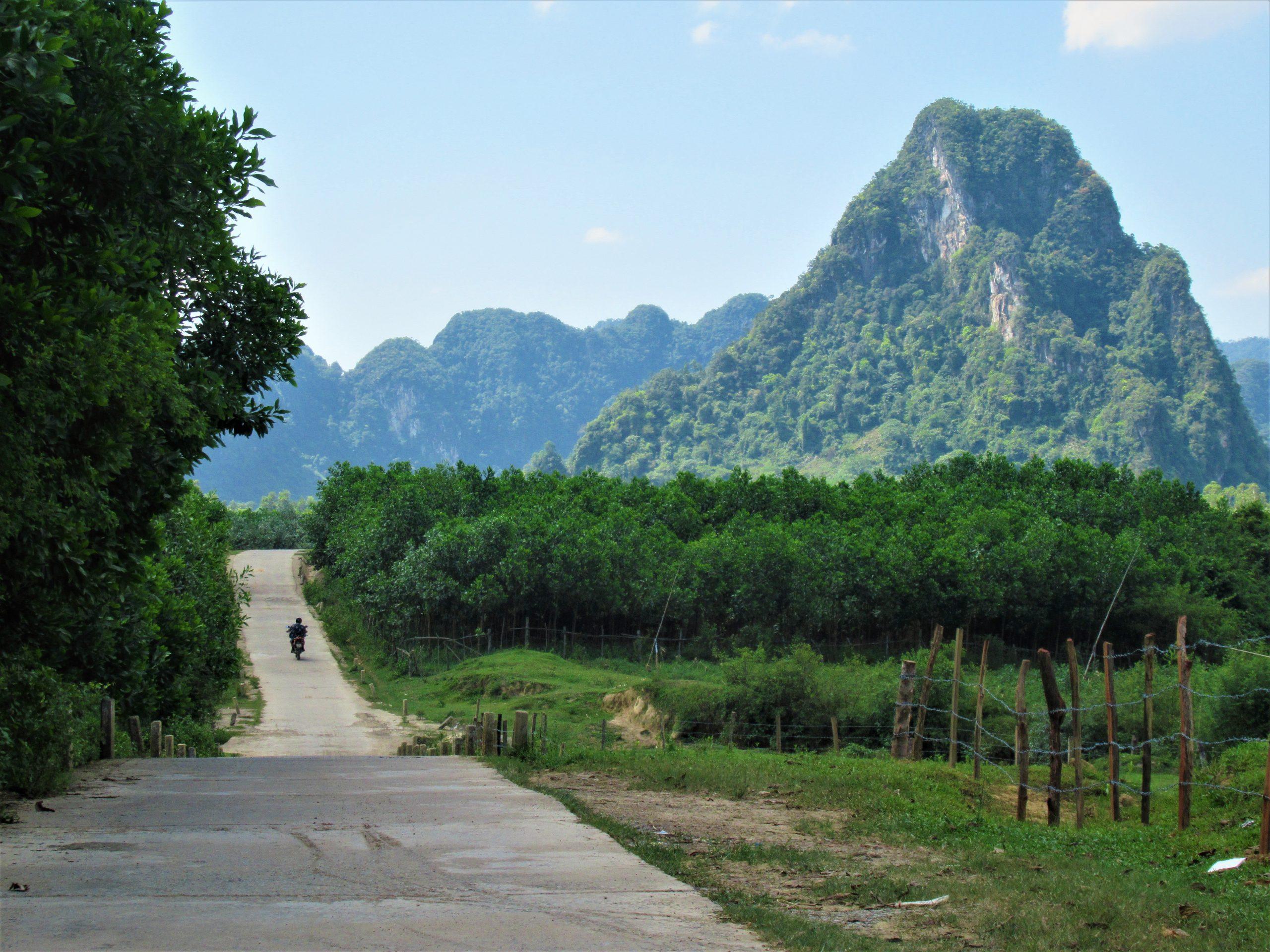 Riding into the limestone karsts on the King Kong Loop, Phong Nha, Central Vietnam
