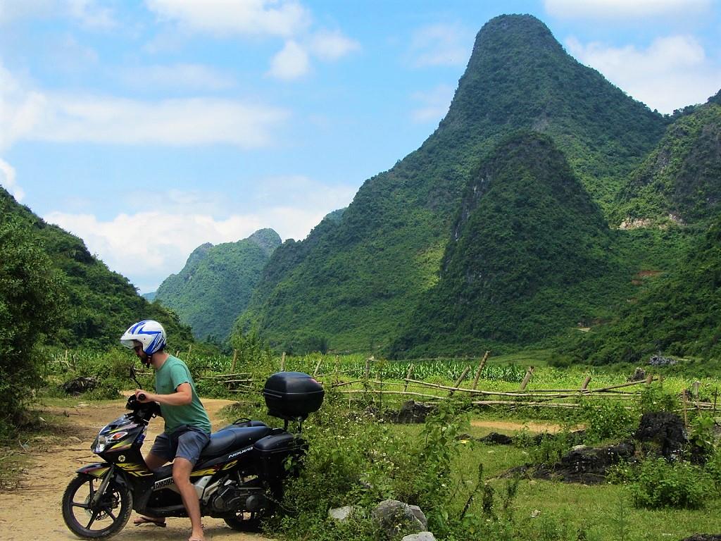 Riding through karst scenery on the Mau Son Mountain Loop, northern Vietnam